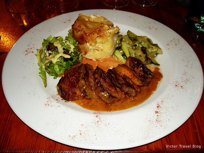 Meat with jam and gratin. Provence, France.