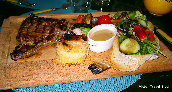 Steak with gratin. Provence, France.