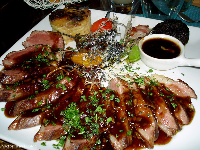 Roast duck with gratin. Provence, France.