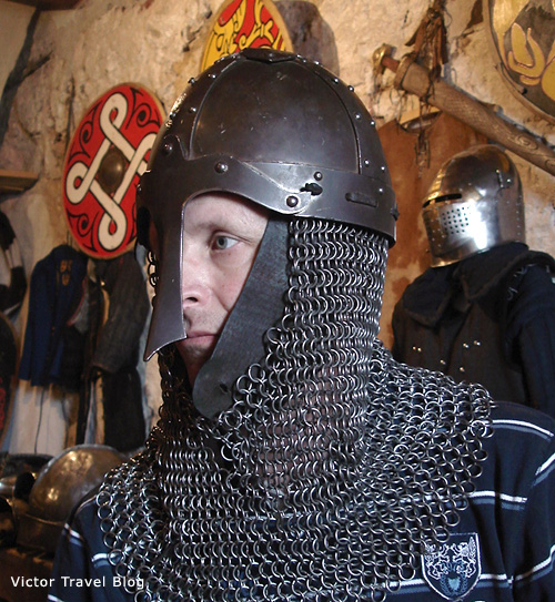 I am in long, heavy chainmail armor.