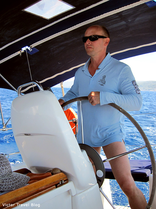 At the helm of the yacht Bavaria 33 during the seiling in Croatia. Croatia.