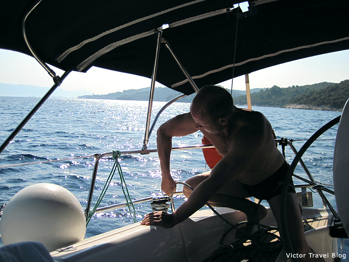 I am learning to set the sails during the sailing in Croatia.