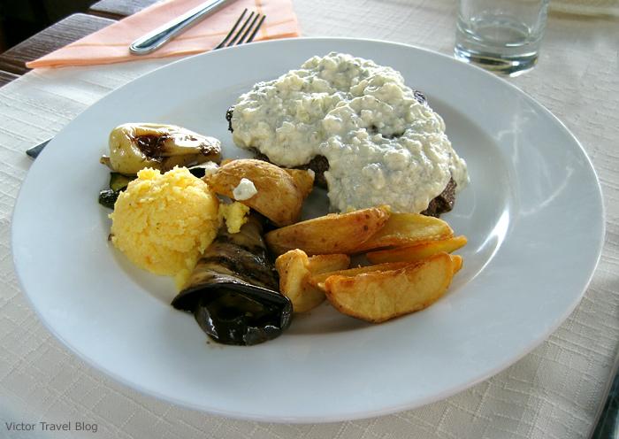 Steak under the gorgonzola sauce. Trogir. Croatia.