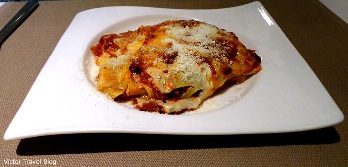 Classic Italian lasagna with ground beef, onion, Mozzarella, Ricotta, Parmesan cheeses, tomato sauce, and lasagna noodles.
