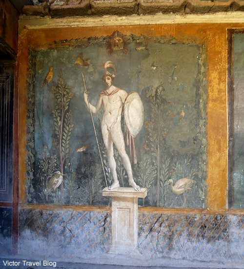 Fresco of Appolo in the House of Venus. Pompeii, Italy.