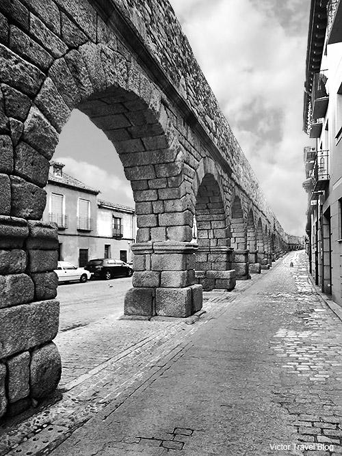 The Aqueduct of Segovia located in the Plaza del Azoguejo. Spain.