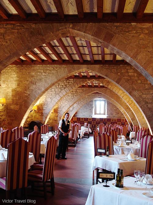 A dining room of the Parador Duques De Cardona Hotel, Catalonia, Spain.