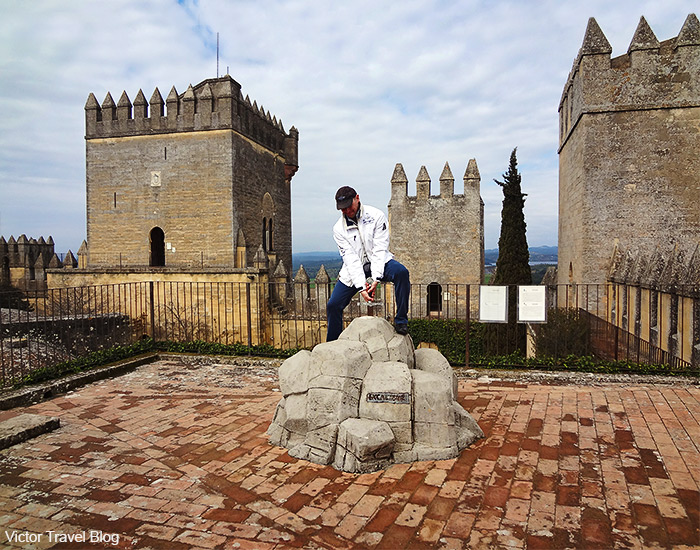 Trying to pull the Excalibur from the stone in the Castillo de Almodovar del Rio. Andalusia, Spain.
