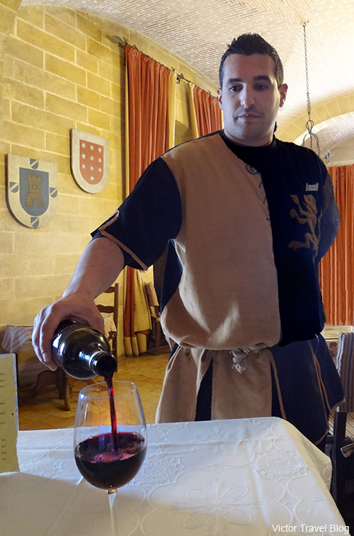 The waiter in the restaurant of the Almodovar castle. Andalusia, Spain.
