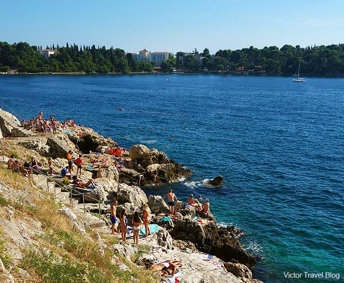 The rocky shore of Rovinj. Istria, Croatia.