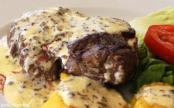 A steak with truffle sauce in the trattoria Sidro. Rovinj, Istria, Croatia.