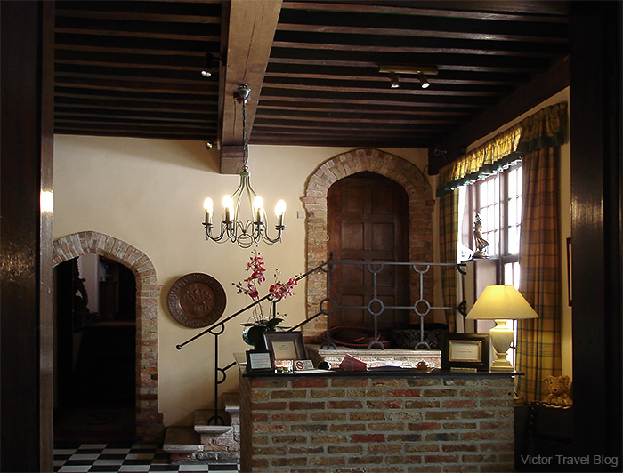 The cozy lobby with fireplace and around-the-clock tea. Hotel Egmond. Brugge, Belgium.