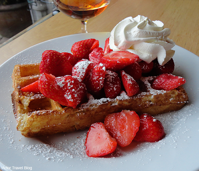 Waffles with strawberries and cream. Brugge, Belgium.