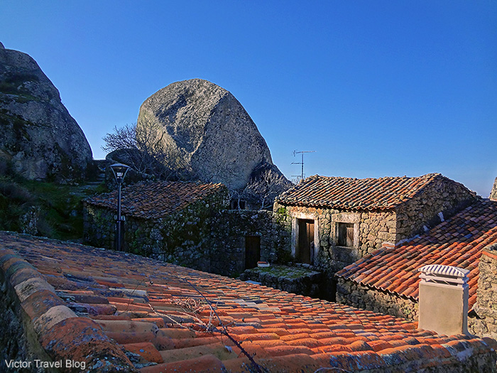 The houses between boulders in the village of Monsanto. Portugal.
