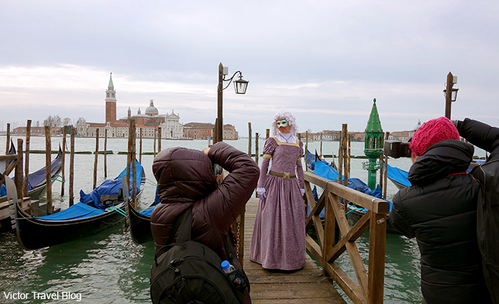 Irina in the masquerade outfit. Venice Carnival. Italy.