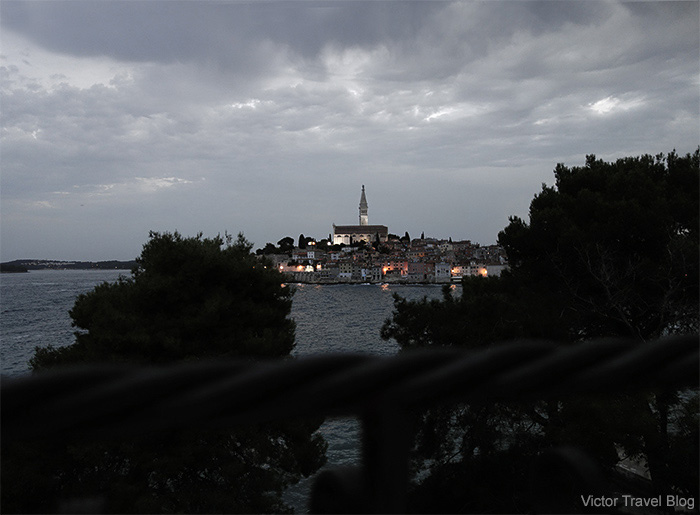 View of night Rovinj from Sveta Katarina Island, Croatia.