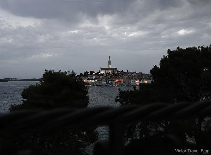 View of night Rovinj from Sveta Katarina Island, Croatia.