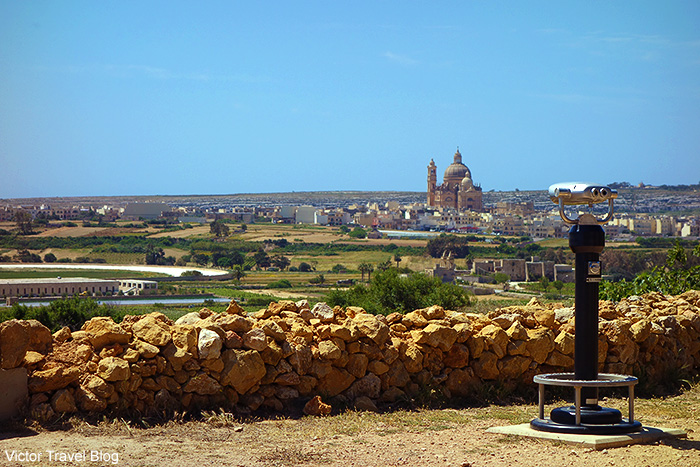 The view of the Church of Saint John the Baptist, Xewkija, from the Ggantia Temple. Gozo island, Malta.