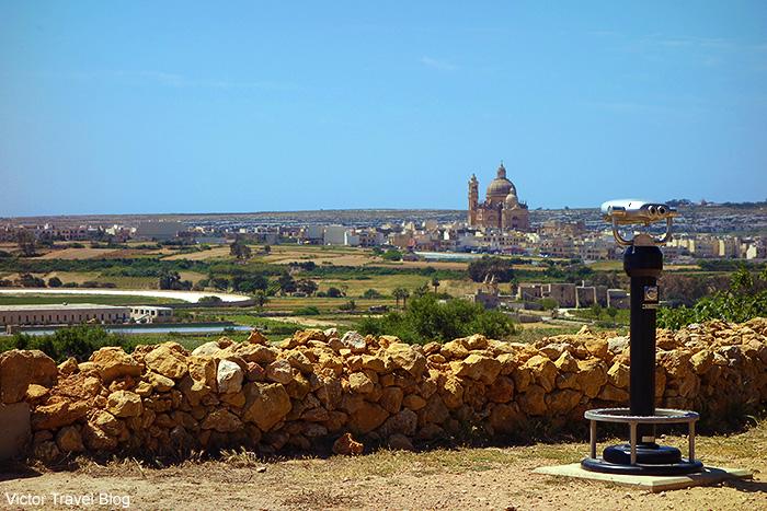 The view of the Church of Saint John the Baptist, Xewkija, from the Ggantia Temple. Gozo island, Malta.