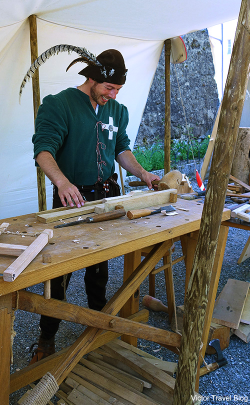 Carpenter. Summer solstice celebration in Gruyeres, Switzerland.
