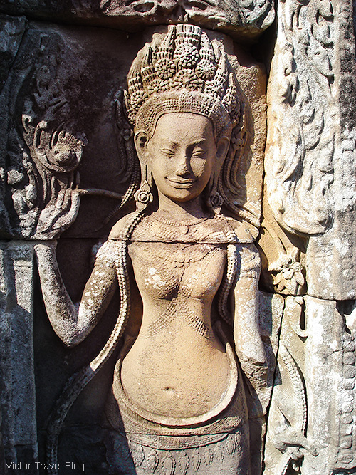 Ancient apsara. Carving in the Khmer temple of Bayon. Angkor Complex, Cambodia.