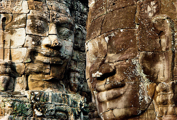 Stone faces of the Bayon Temple. Angkor Complex, Cambodia.