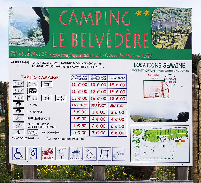 Prices of the camping area. The Belvedere. Chateaux de Lastours. Pays Cathare, Languedoc, France.