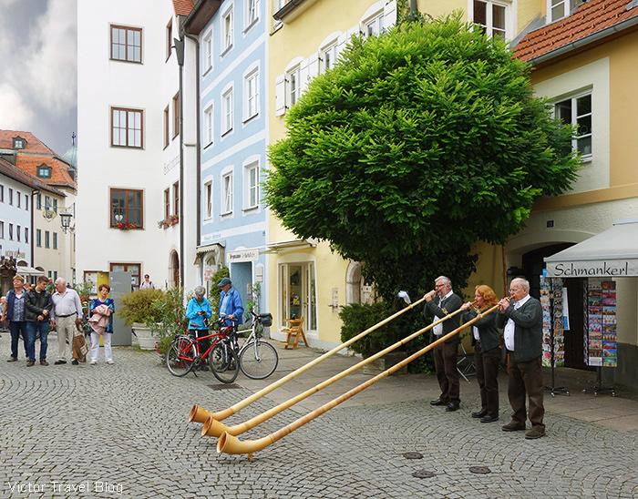 Alphornblazer. Fuessen, Bavaria, Germany.