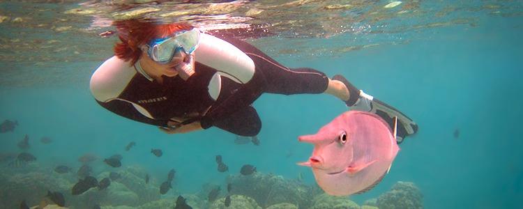 Irina and a very curious fish. Fihalhohi Island Resort, the Maldives.