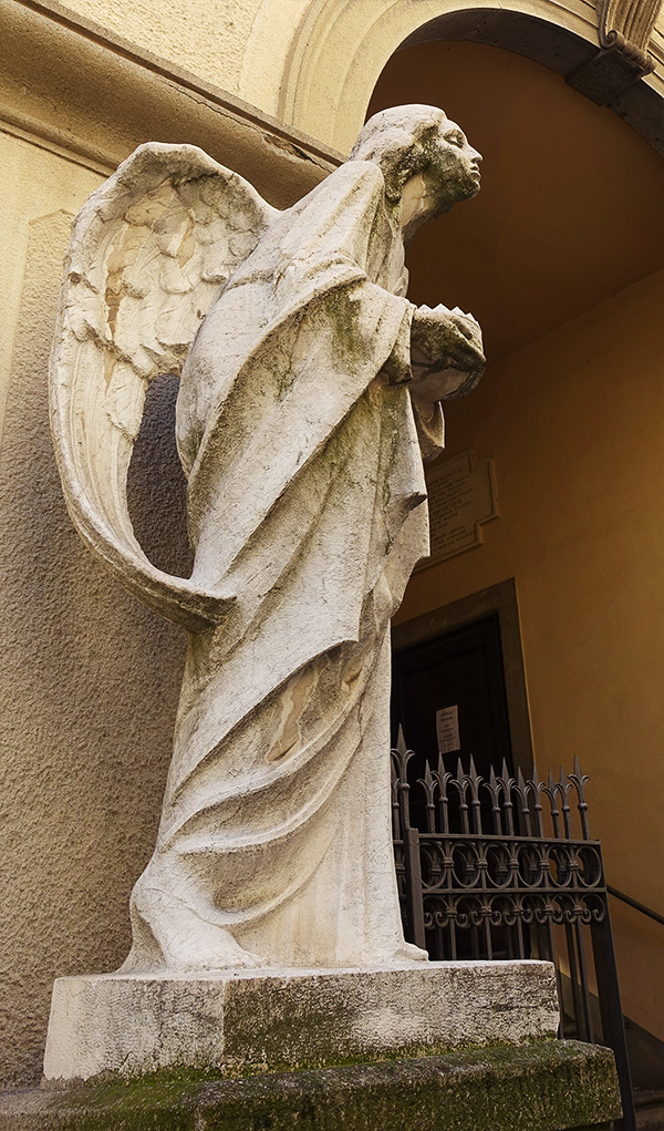 Beautiful and sorrowful angel near Chiesa di San Salvatore, Bergamo, Italy.