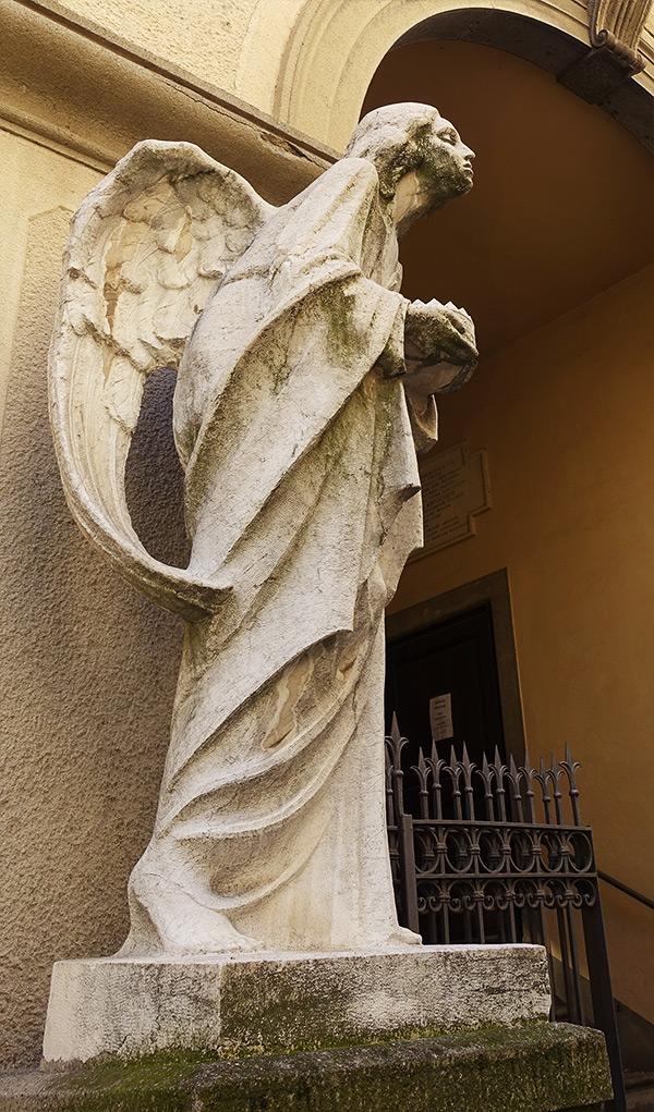 Beautiful and sorrowful angel near Chiesa di San Salvatore, Bergamo, Italy.