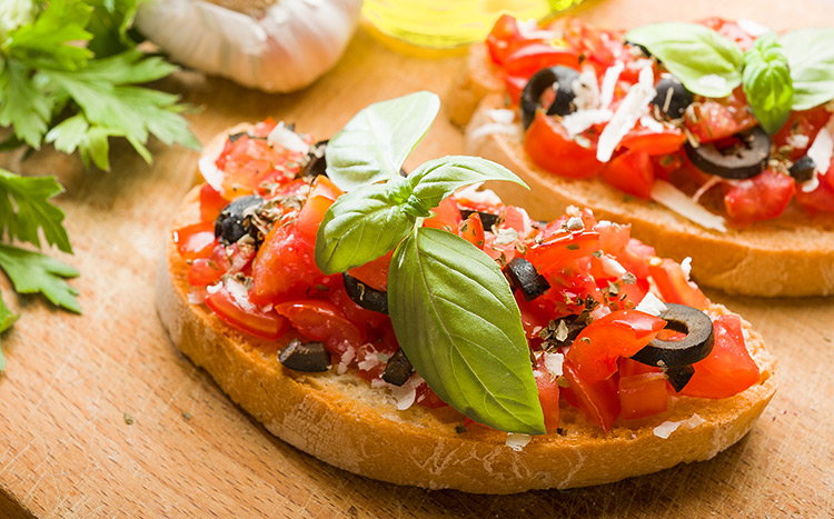 Bruschetta with tomatoes and olives.