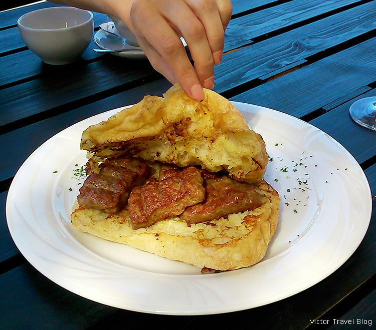 Cevapcici u lepenji - small cutlets in bread. Budva, Montenegro.