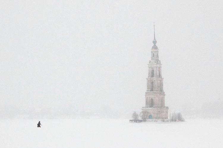 The bell tower of the flooded Kalyazin in winter, Russia.