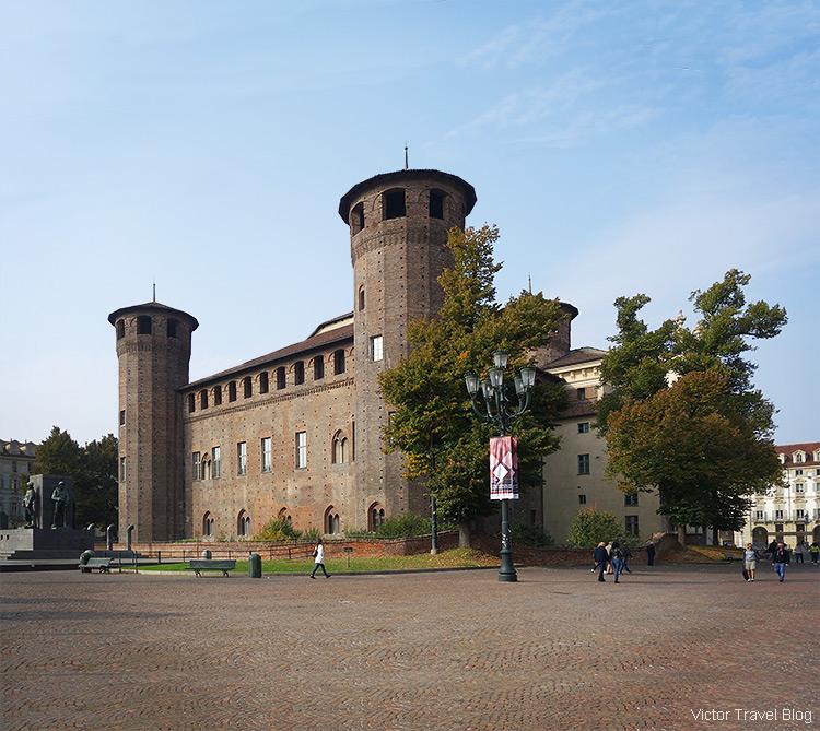 The brown facade of Palazzo Madama e Casaforte degli Acaja, Turin, Italy.